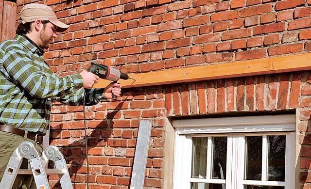 Как выполняется опирание балки на кирпичную стену